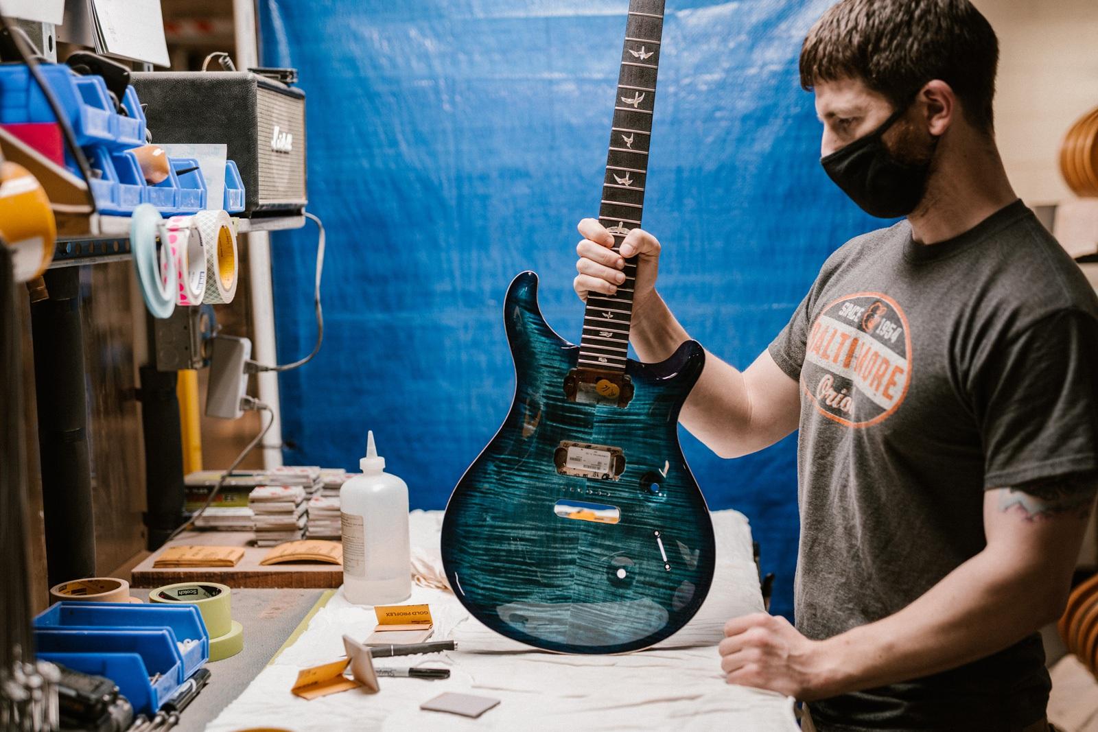 Cobalt Blue Guitar on bench